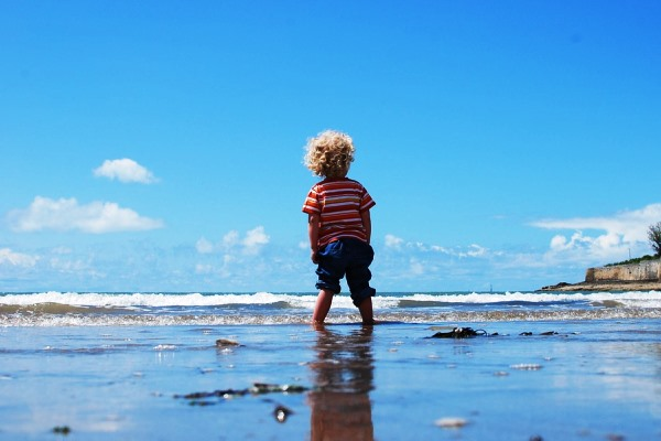 Child Walking on Sand