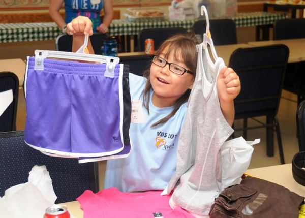 Girl Choosing her Clothes