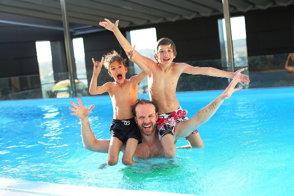 Father Swimming with his Children
